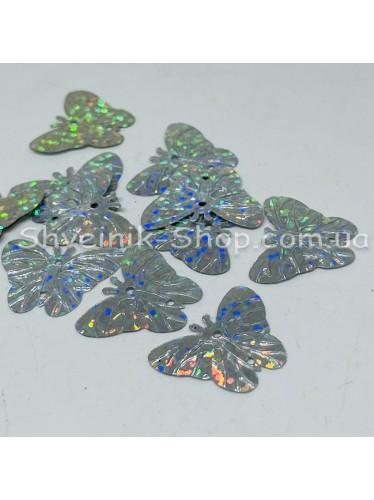 Паетка россыпью бабочка Цвет: серебро голограмма Размер: длина 2 см ширина 2 см в упаковке 500г цена за упаковку