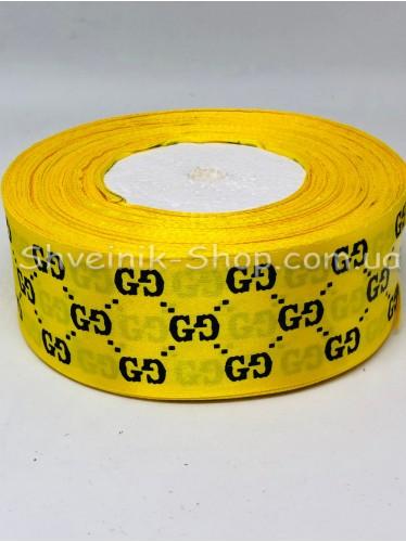 Лента атласная с рисунком GG Ширина 4 см в упаковке 46м Цвет: Желтый
