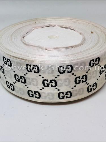 Лента атласная с рисунком GG Ширина 4 см в упаковке 46м Цвет: Белый